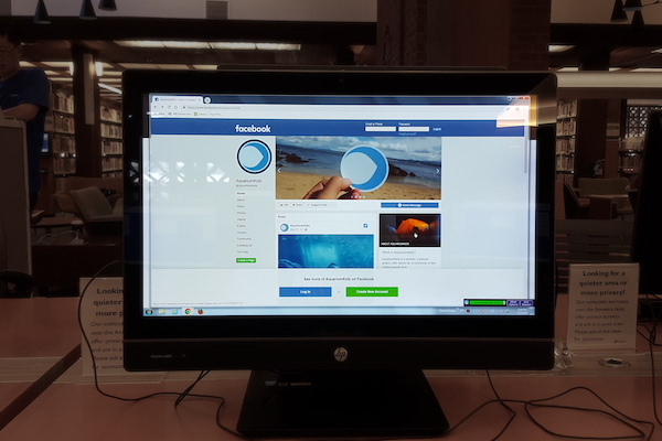 AquariumKids' Facebook page on a computer monitor at the Palo Alto Rinconada library